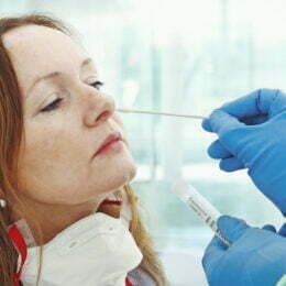 Medic taking sample from patients nose for coronavirus testing